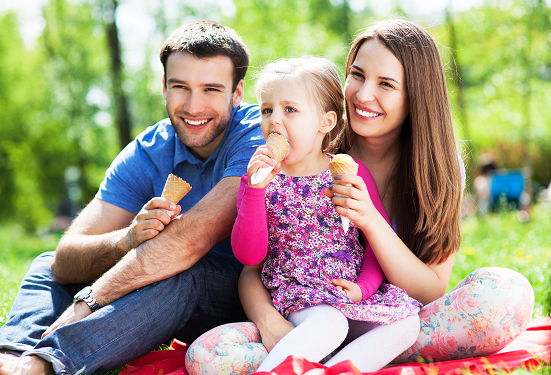 Happy family eating ice cream during their visit to one of Yorkshire Dales' attractions
